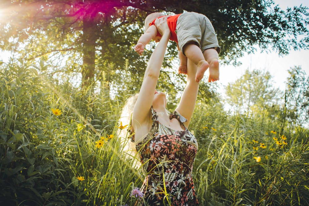Parent and child playing together in summer