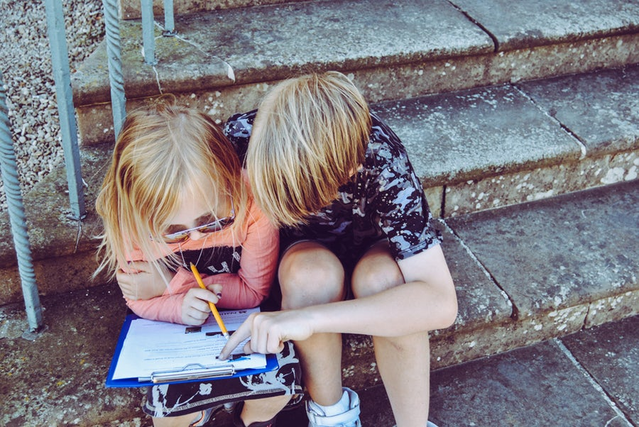 Two children studying together preventing summer learning loss