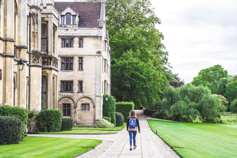 Undergraduate student walking through Cambridge University